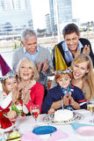 Parents congratulating to child's royalty free stock photography