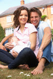 Parents Cuddling Newborn Baby Boy Outdoors At Home Royalty Free Stock Image