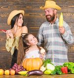Parents and daughter celebrate autumn harvest festival. Family rustic style farmers at market with vegetables fruits and royalty free stock photo