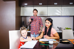 Parents with a daughter draw Stock Photography