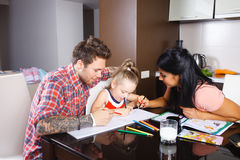 Parents with a daughter draw Stock Photos