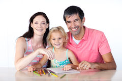 Parents and daughter drawing Stock Images