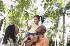 Parents With Daughter Enjoying In Park Stock Photos