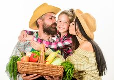 Parents and daughter farmers celebrate harvest holiday. Family farm concept. Family farmers hug hold basket fall harvest. Family gardeners basket harvest stock images