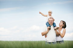 Parents with daughter in the field Royalty Free Stock Image