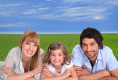 Parents and daughter on grass Royalty Free Stock Photography