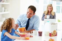 Parents And Daughter Having Breakfast In Kitchen Together Royalty Free Stock Photography