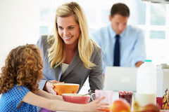 Parents And Daughter Having Breakfast In Kitchen Together Royalty Free Stock Photos