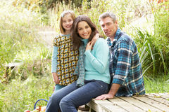 Parents And Daughter Having Picnic Stock Photography