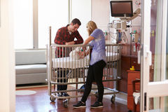 Parents With Daughter In Hospital Pediatric Unit Royalty Free Stock Photo