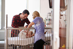 Parents With Daughter In Hospital Pediatric Unit Royalty Free Stock Photography