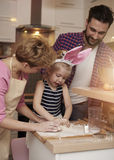 Parents with daughter in the kitchen stock image