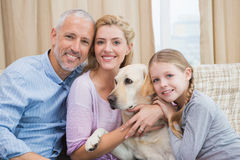 Parents and daughter with pet labrador Stock Image
