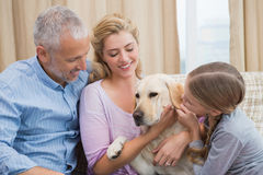 Parents and daughter with pet labrador Royalty Free Stock Images