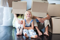 Parents and daughter playing at home with boxes Stock Images