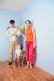 Parents with daughter in room after repair Stock Images