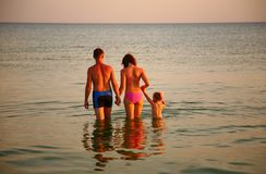 Parents with daughter in sea Stock Images