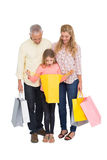Parents and daughter with shopping bags Royalty Free Stock Photos