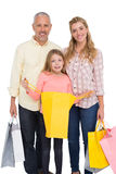 Parents and daughter with shopping bags Royalty Free Stock Image