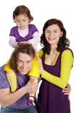 Parents and daughter sits on father's shoulder Stock Photos