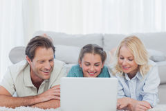 Parents and daughter using a laptop Royalty Free Stock Images