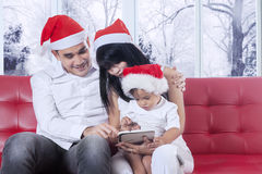 Parents and daughter using a tablet together Stock Image