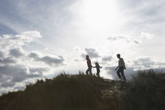 Parents And Daughter Walking On Sand Dunes Royalty Free Stock Photography