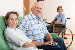 Parents and daughter in wheelchair Stock Photos