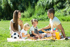 Parents with  daughters having  picnic Stock Photography