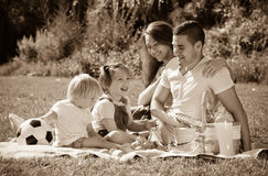 Parents with daughters having picnic Royalty Free Stock Photo
