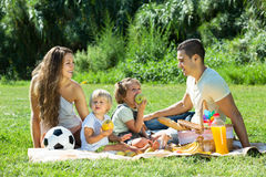 Parents with  daughters having picnic Royalty Free Stock Image