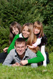 Parents and daughters in park Stock Photos