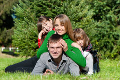 Parents and daughters in park Royalty Free Stock Images
