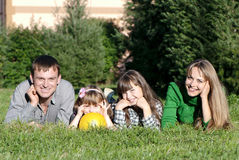 Parents and daughters in park Stock Images
