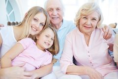 Parents and daughters. Portrait of senior couple with their daughter and granddaughter looking at camera Stock Images