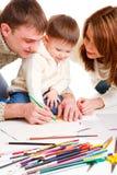 Parents dessinant avec le fils Image libre de droits