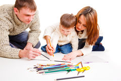 Parents drawing with son. Parents drawing together with  their toddler son Stock Photo
