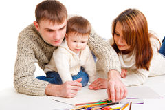 Parents drawing with son. Parents drawing together with  their toddler son Stock Photography
