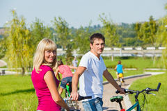 Parents enjoying cycling Stock Photo