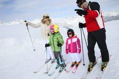 Parents explaining their children how to ski Royalty Free Stock Image