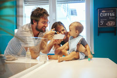 Parents Feeding Baby. Parents Feeding Their Son At Home stock photography