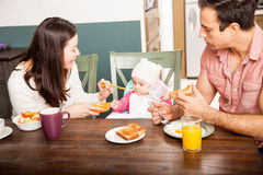 Parents feeding their baby at home Royalty Free Stock Photos