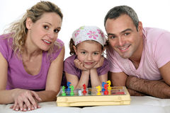 Parents and girl playing chess Royalty Free Stock Photos