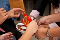 The parents give money to bride and groom in Chinese marriage Stock Photography