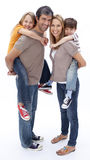 Parents giving children piggyback ride Stock Photography