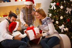 Parents giving Christmas gift to son. Parents giving Christmas gift to their little son Stock Photography