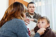 Parents giving medicinal sirup to teenage Stock Photo