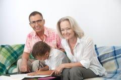 Parents grands avec l'enfant Photographie stock libre de droits