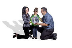 Parents Handing Over A Green Earth To Their Child Royalty Free Stock Photos