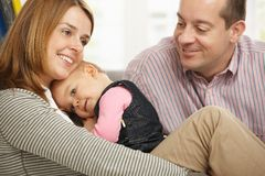 Parents with happy baby Stock Images